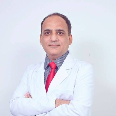 Dr Anil Minocha